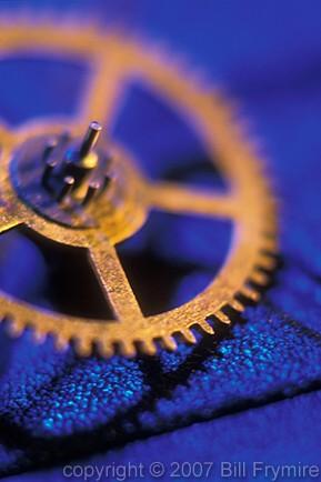 gold-gear-on-blue-closeup.jpg