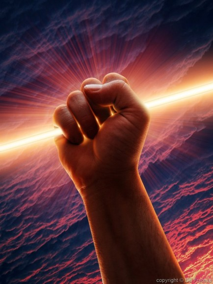 a human hand in the form of a fist gripping on to a beam of light through the clouds
