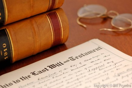 last will and testament shown with glasses and books