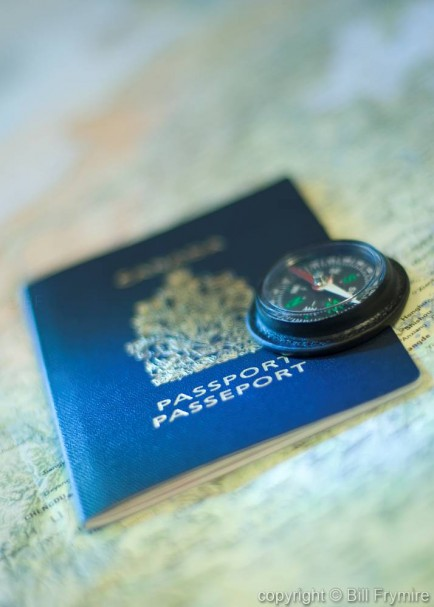 photo of a passport with compass on top representing travel