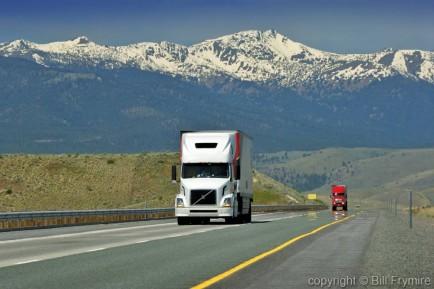 Transport Trucks near La Grande. Oregon, USA. Interstate 84 - up hill