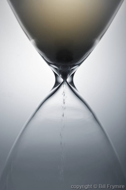 close-up of sand falling through the hourglass -