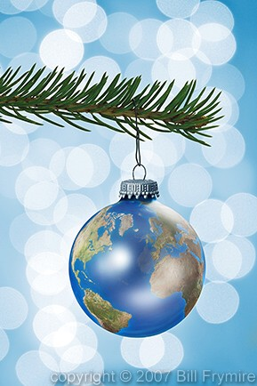 Earth globe Christmas ornament on pine tree branch