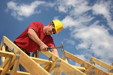 index » industry » housing » carpenter building house on trusses