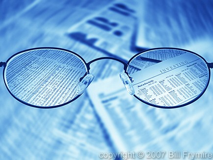 focused-investing-glasses-stock-market-sheet