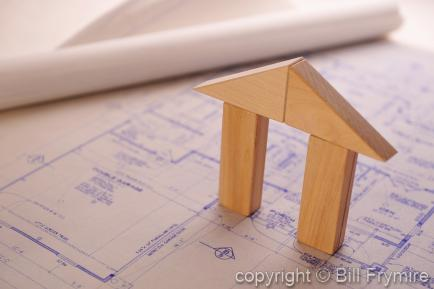 wooden block house on blueprints