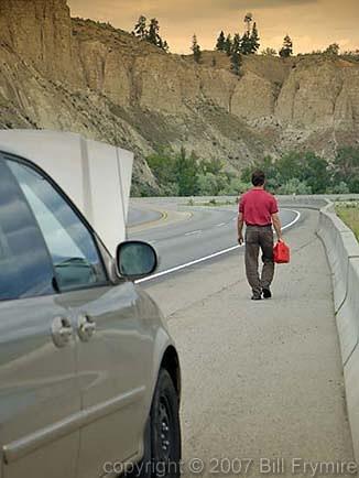 man walking for gas on highway. Black Bedroom Furniture Sets. Home Design Ideas