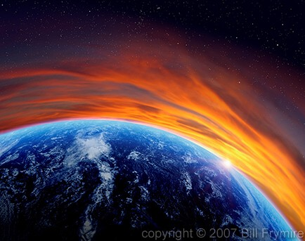 View of Earth from space with a sunrise sunset on horizon.