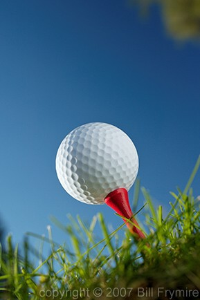 worm's eye view of a golf ball on tee