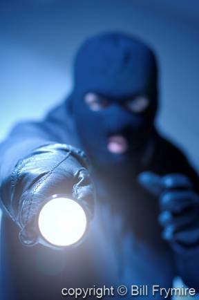 thief-crime-with-flashlight