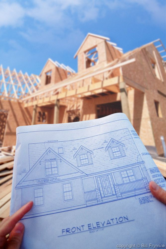 New home construction with blueprints for Home building blueprints