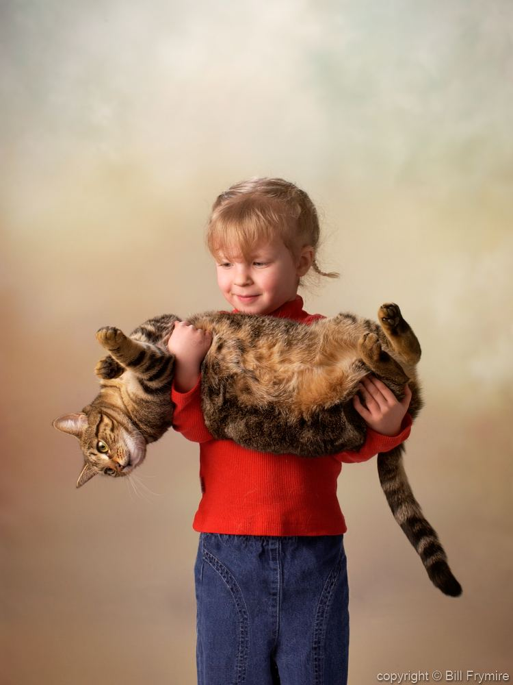 Young Girl Holding Cat