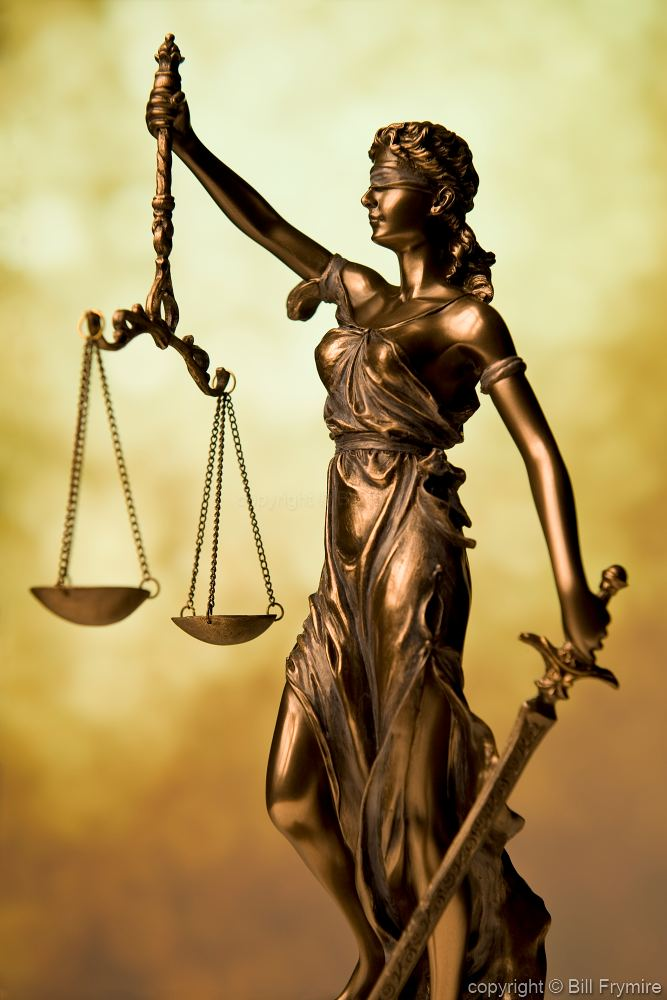 Statue of Lady Justice Holding Scales of Justice