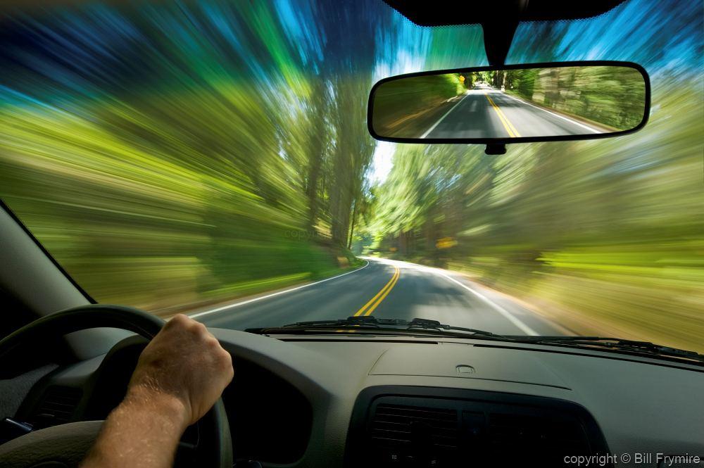 driver speeding on road