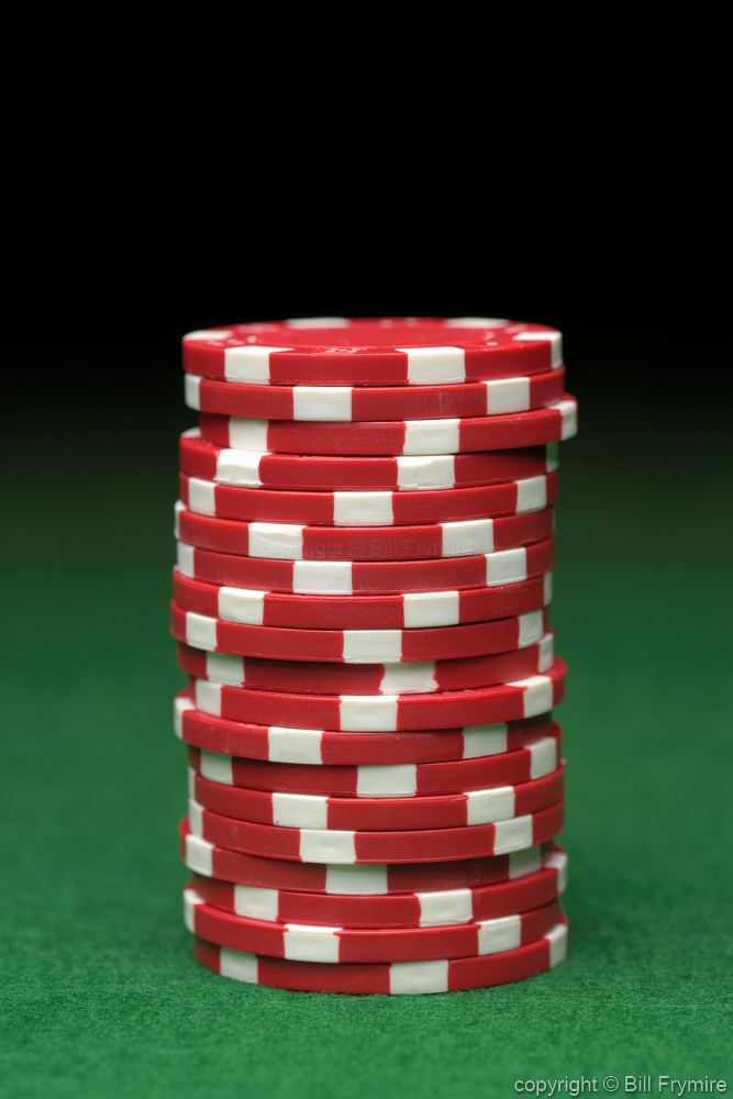 Stack Of Red Poker Chips Green Felt
